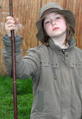 Girl with stick — Stock Photo