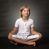 Smiling girl sitting — Stock Photo