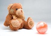 Teddy bear with ball — Stock Photo