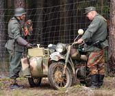 German soldiers and military motorcycle — Stock Photo
