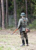 German soldier in battlefield — Stock Photo