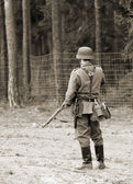German soldier in battlefield WWII — Stock Photo