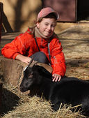 Girl with goat — Stock Photo