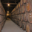 Wooden wine barrels hold Port,Porto, Portugal — Stock Photo #12827932