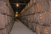 Wooden wine barrels hold Port,Porto, Portugal — Stock Photo
