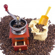 Burr coffee mill manual with coffee beans — Stock Photo #16971491