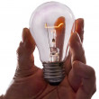 Bright clear glass lit incandescent electric light bulb with glo — Stock Photo