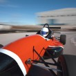 Red bolide driving at high speed in circuit.Camera on board view — Stock Photo #16972153