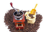 Burr coffee mill manual with coffee beans — Stock Photo