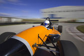 Bolide driving at high speed in circuit.Camera on board view bac — Foto Stock