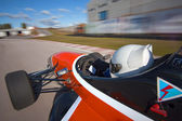 Red bolide driving at high speed in circuit.Camera on board — Stock Photo
