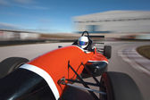 Red bolide driving at high speed in circuit.Camera on board view — Stockfoto