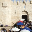 Foto de Stock  : Editorial shoppers at Damascus Gate Palestine Old City