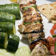 Chicken shish kabob with zucchini salad Greek style as photogra — Stock Photo