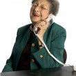 Laughing senior woman on telephone — Stock Photo #12905536