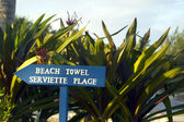 Beach towel sign — Stock Photo