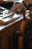 Captain's controls beautiful wooden boat — Stock Photo