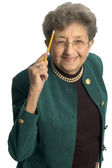 Healthy senior woman pointing to head — Stock Photo
