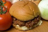 Sloppy joe sandwich with tomatoes onions — Stock Photo
