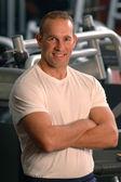 Hombre centro fitness — Foto de Stock