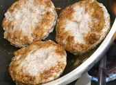 Pork sausage patties — Stock Photo