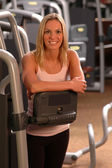 Beautiful woman in fitness gym — Stock Photo