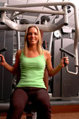 Pretty woman in fitness center — Stock Photo