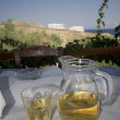 Wine on table greek island view — Stockfoto