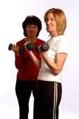 Vackra kvinnor i fitness gym — Stockfoto