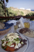 Greek taverna lunch over sea view — Stock Photo