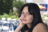 Pretty woman at greek island cafe — Stock Photo