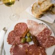 Ham and salami plate rome restaurant — Stockfoto #12921387