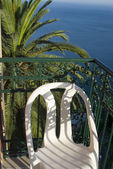 Hotel deck patio over sea — Stock Photo