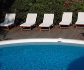 Pool with lounge chairs — Stock Photo