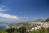 Panoramic view of taormina and mt. etna — Stock Photo
