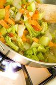 Stir fried vegetables on the range — Stock Photo