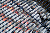 Flaming barbecue charcoal — Stock Photo