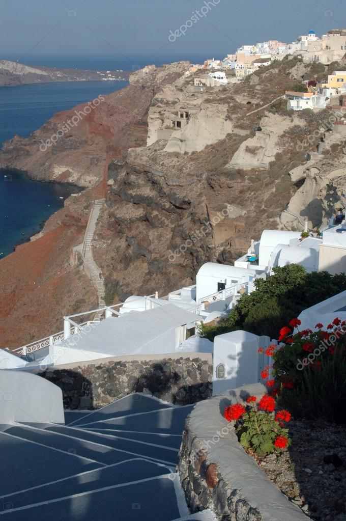 Greek island view churches hotels houses on sea santorini — Stock Photo #13056160