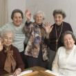 Senior women at the game table — Stock Photo