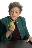 Senior woman with apple — Stock Photo