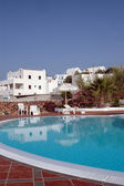 Hotel pool with greek island architecture — Stock Photo