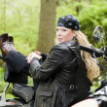 Woman on motorcycle — Stock Photo #13070875