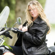 Woman on motorcycle — Stock Photo #13071091