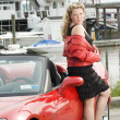 Woman red sports car — Stock Photo #13071432