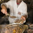 Lamb tagine at outdoor restaurant in jemaa el fna plaza square — Stockfoto