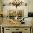 Kitchen island with wine baguettes — Stock Photo