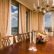 Stock Photo: Penthouse dining room with view new york city