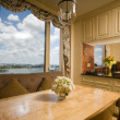 Dining table in kitchen nook penthouse new york - Stock Photo