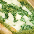Organic pizza spinach basil pesto cheese — Stock Photo