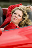 Woman red sports car — Stock Photo